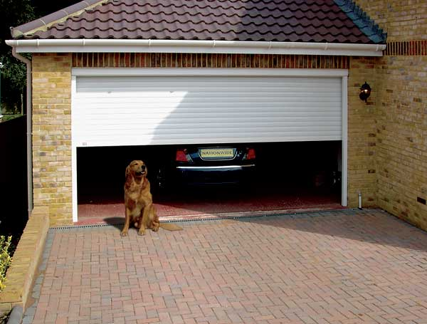 How much does it cost to have a new garage door installed for How much does it cost to replace garage door motor
